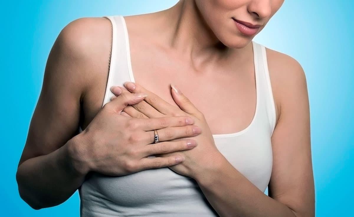 Грудь набухла и болит: причины, симптомы и диагностика