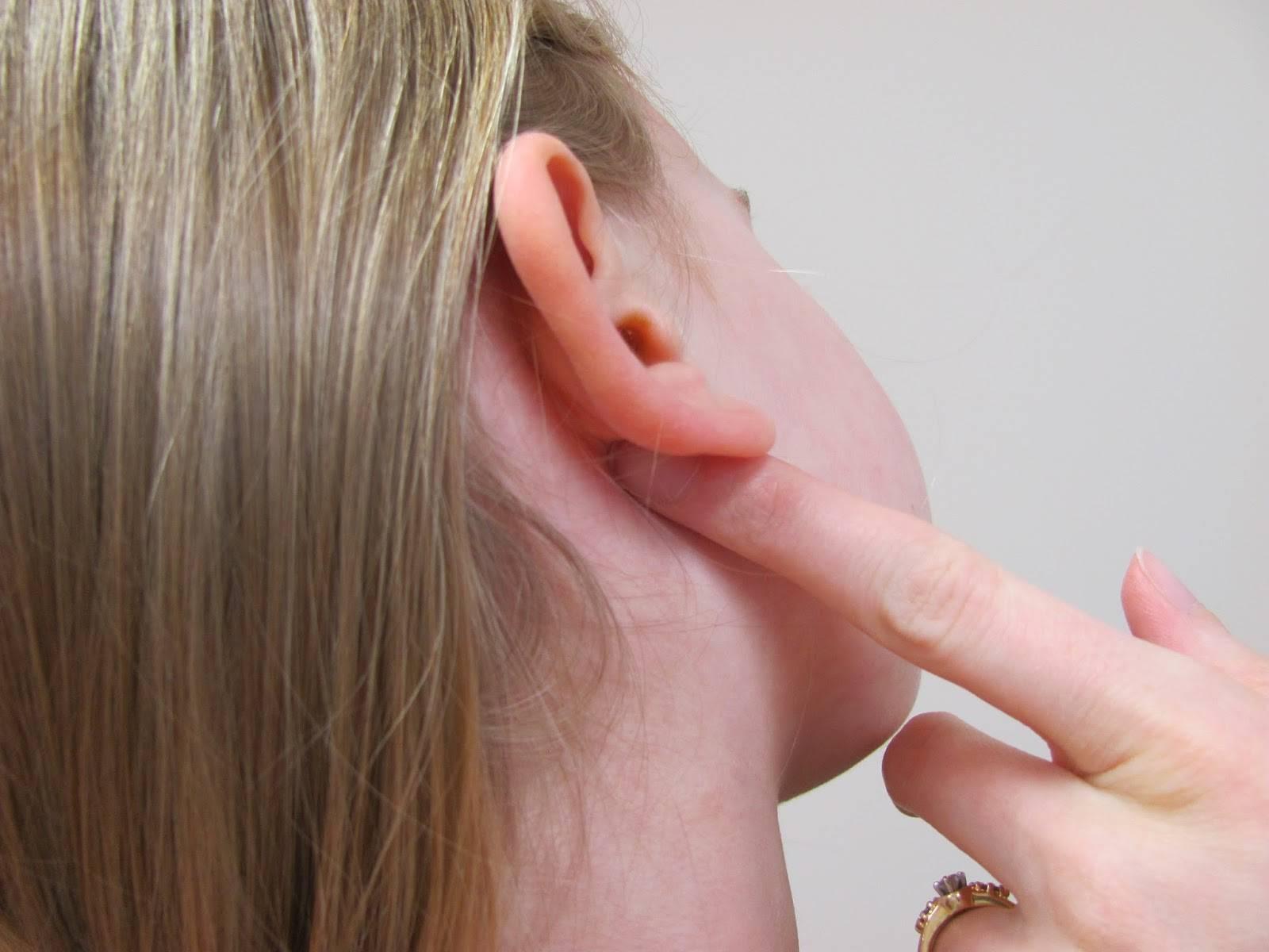 болит за ушами при нажатии
