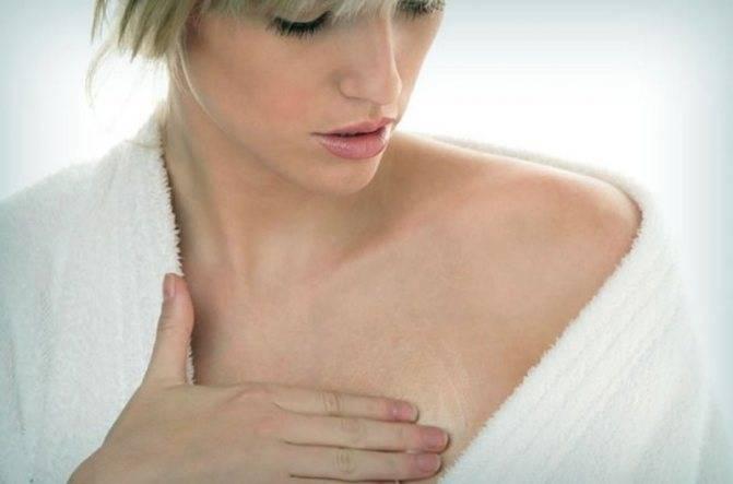 В середине цикла болит грудь увеличивается