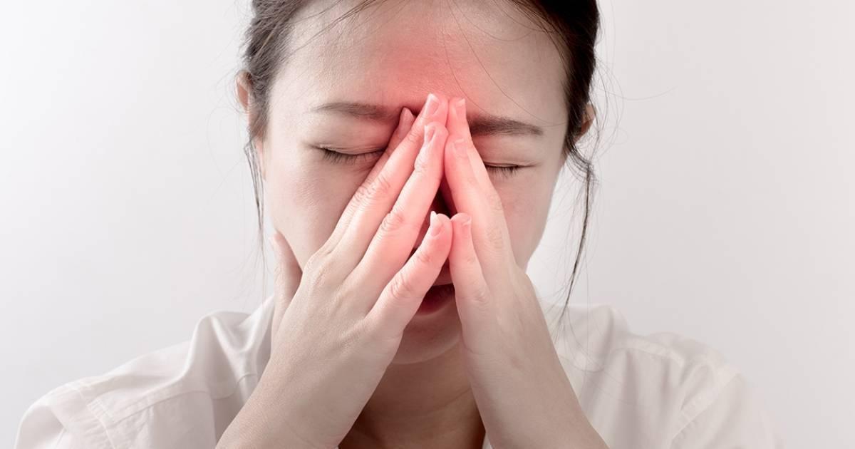 Причины боли в переносице
