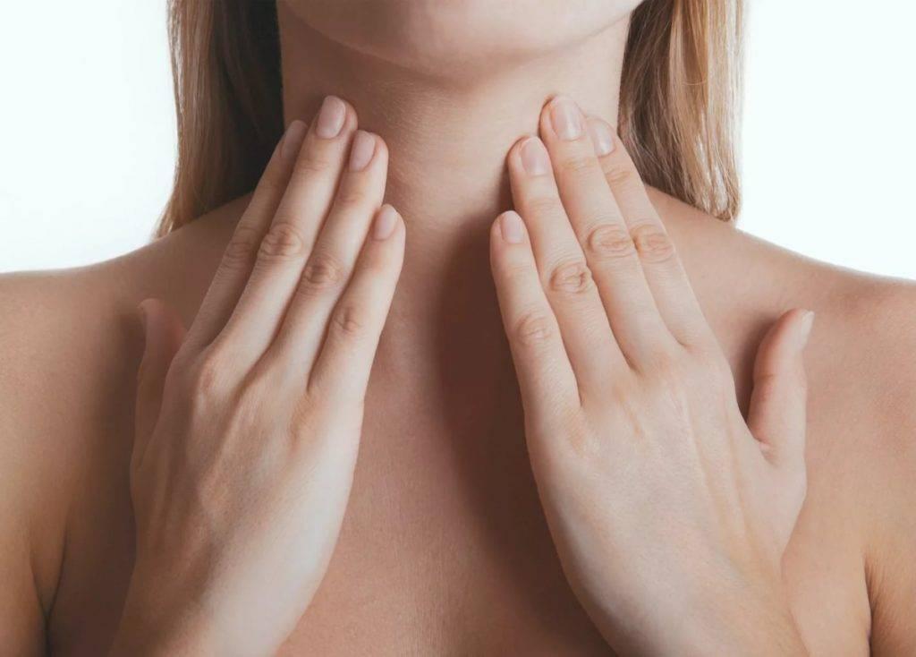 боль в области щитовидки