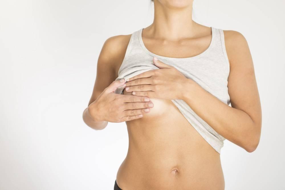 Почему болит правая грудь